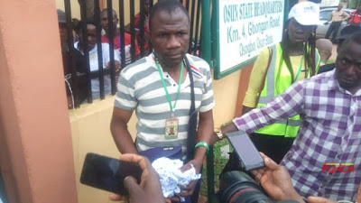 Image result for #OsunVotes: INEC staff embarrased for tearing election result