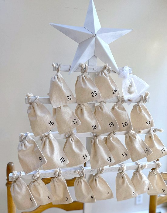 Muslin numbered bags tied to a Christmas tree frame