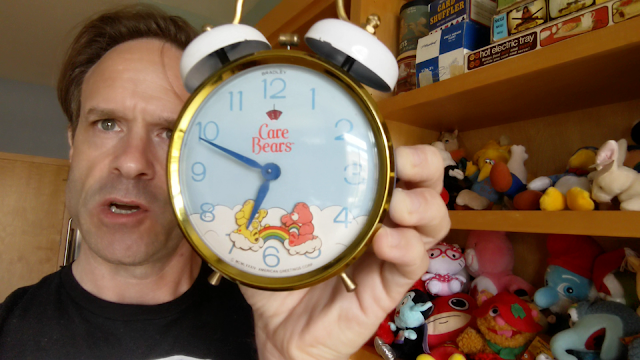 picture of a guy holding an old alarm clock
