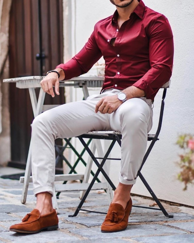 Burgundy shirt and cream color trousers