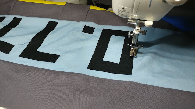 Applique numbers on quilt top