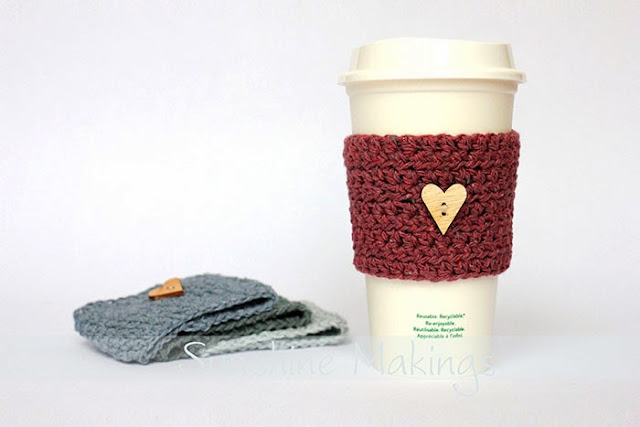 coffee cozy made from recycled denim with a wooden heart