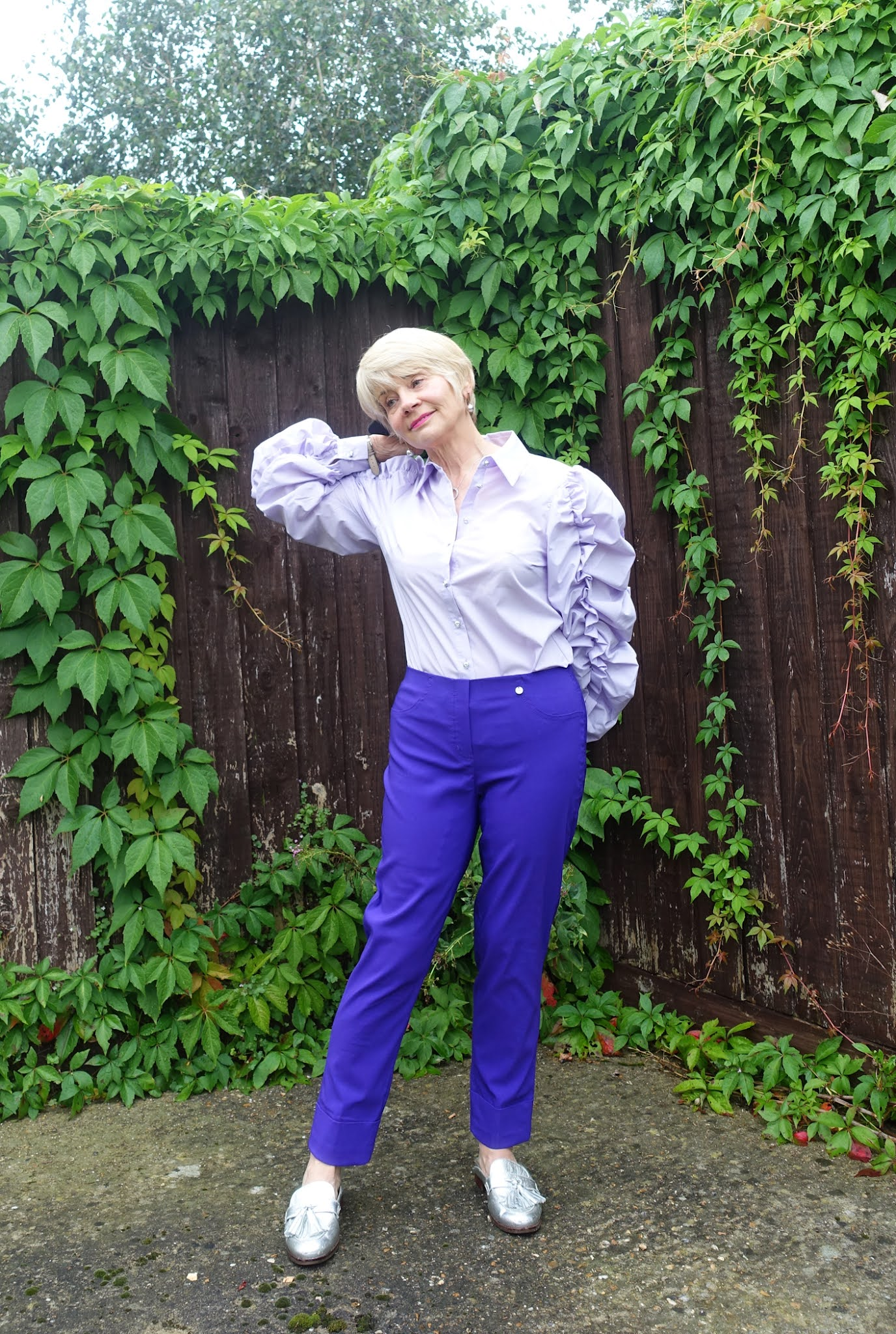 Wearing statement sleeves: Gail Hanlon from Is This Mutton in lilac blouse and purple trousers