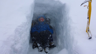 Winter mountaineering snow-hole
