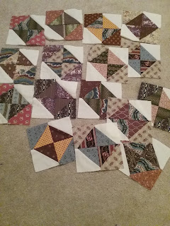 16 hourglass pieced quilt blocks made from reproduction 19th century fabric.