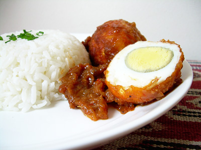 These hard boiled eggs smothered in sauce and served with fresh rice taste amazing.