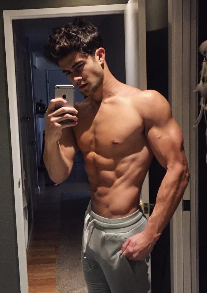 strong-muscular-barechest-dude-abs-selfie