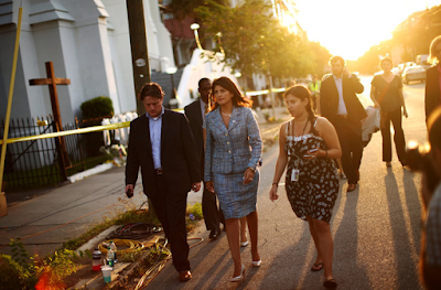 Gov. Nikki R. Haley with journalists at Emanuel African Methodist Episcopal Church in Charleston, S.C., in June 2015, after nine African-Americans were killed at the church. Credit Travis Dove for The New York Times