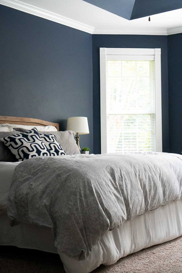 bedroom with Sherwin Williams Naval walls