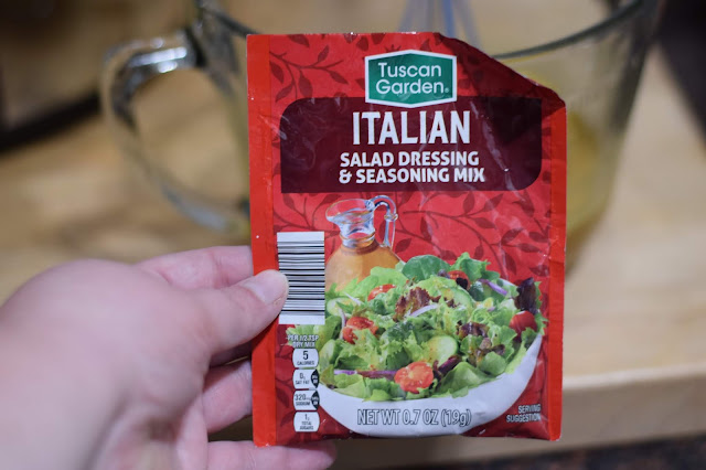 A packet of Italian salad dressing and seasoning mix.