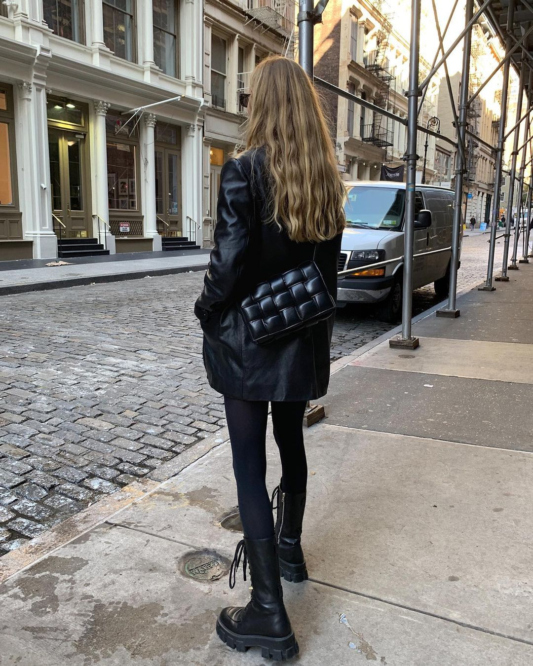 How to Pull Off a Cool All-Black Outfit for Fall —@mvb Marie von Behrens in leather jacket, leggings, lug-sole combat boots, and a  Bottega Veneta Cassette bag