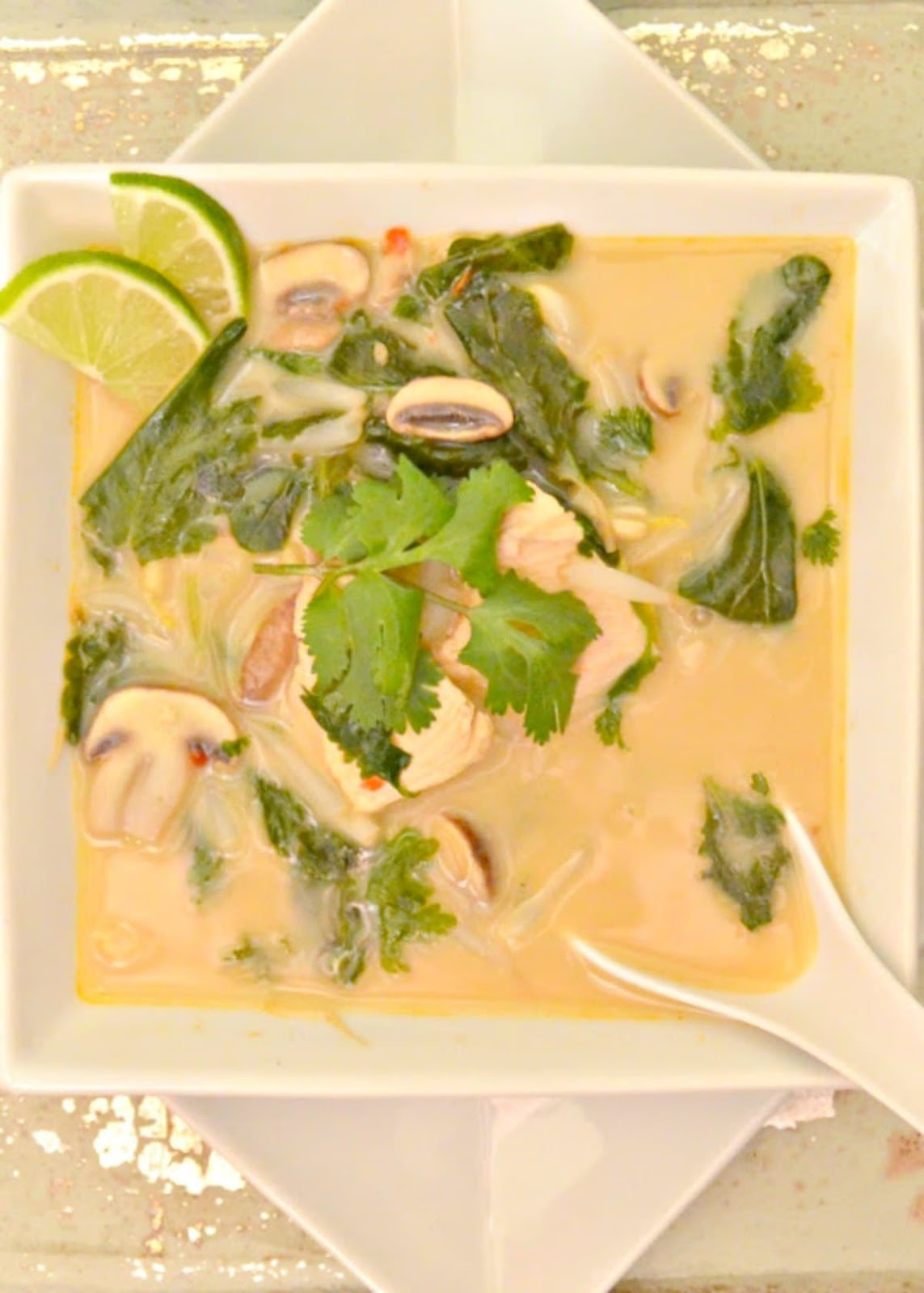 Thai Chicken Coconut Soup or Tom Kha Gai is a delicious Thai Soup recipe our family loves that is easy to make from Serena Bakes Simply From Scratch.