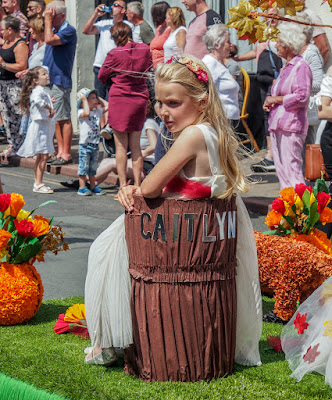 Photo of a pensive moment for a young girl on one of floats