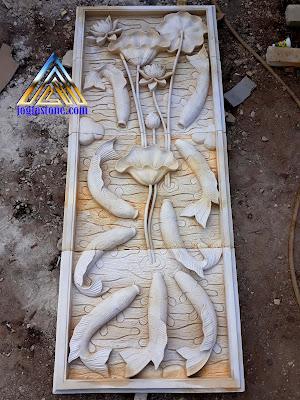 Relief batu alam paras jogja, Batu putih gambar motif lotus dan sembilan koi