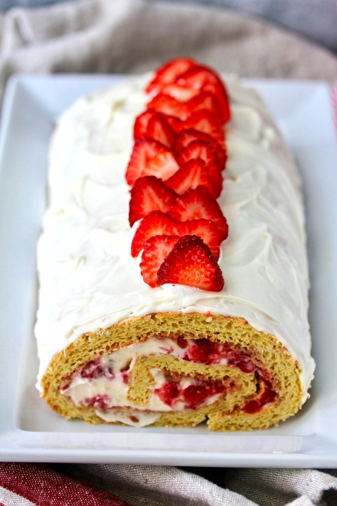 Strawberry Swiss Roll Cake on a plate