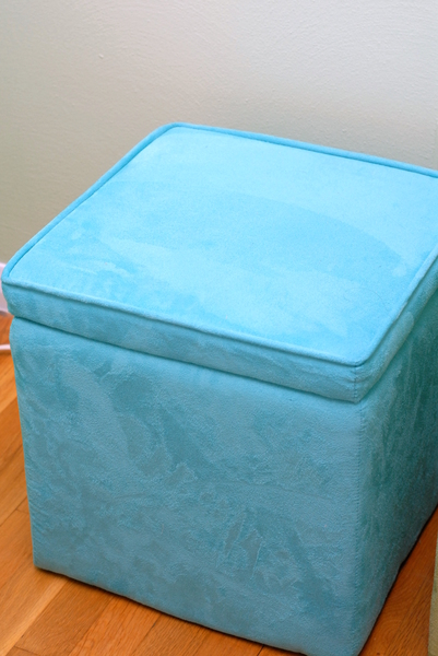 Use your storage ottoman lid for more storage options. anartfulmom.com