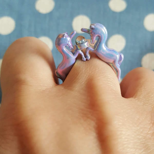 lilac unicorn shaped ring on finger