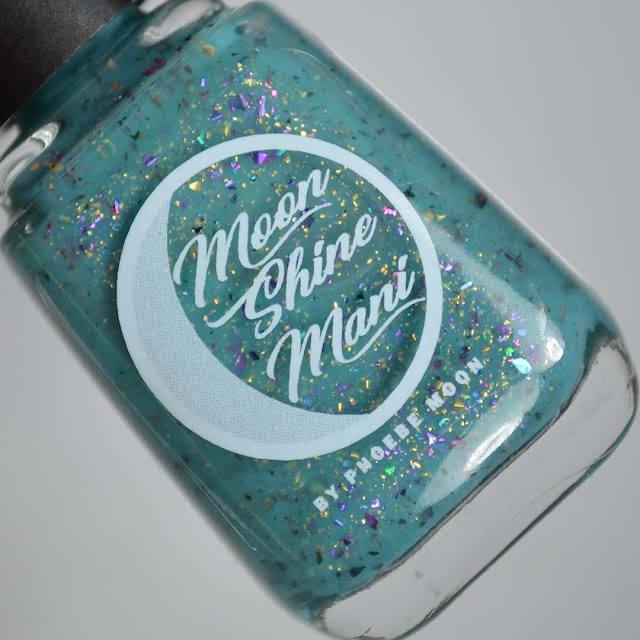 teal nail polish with flakies in a bottle