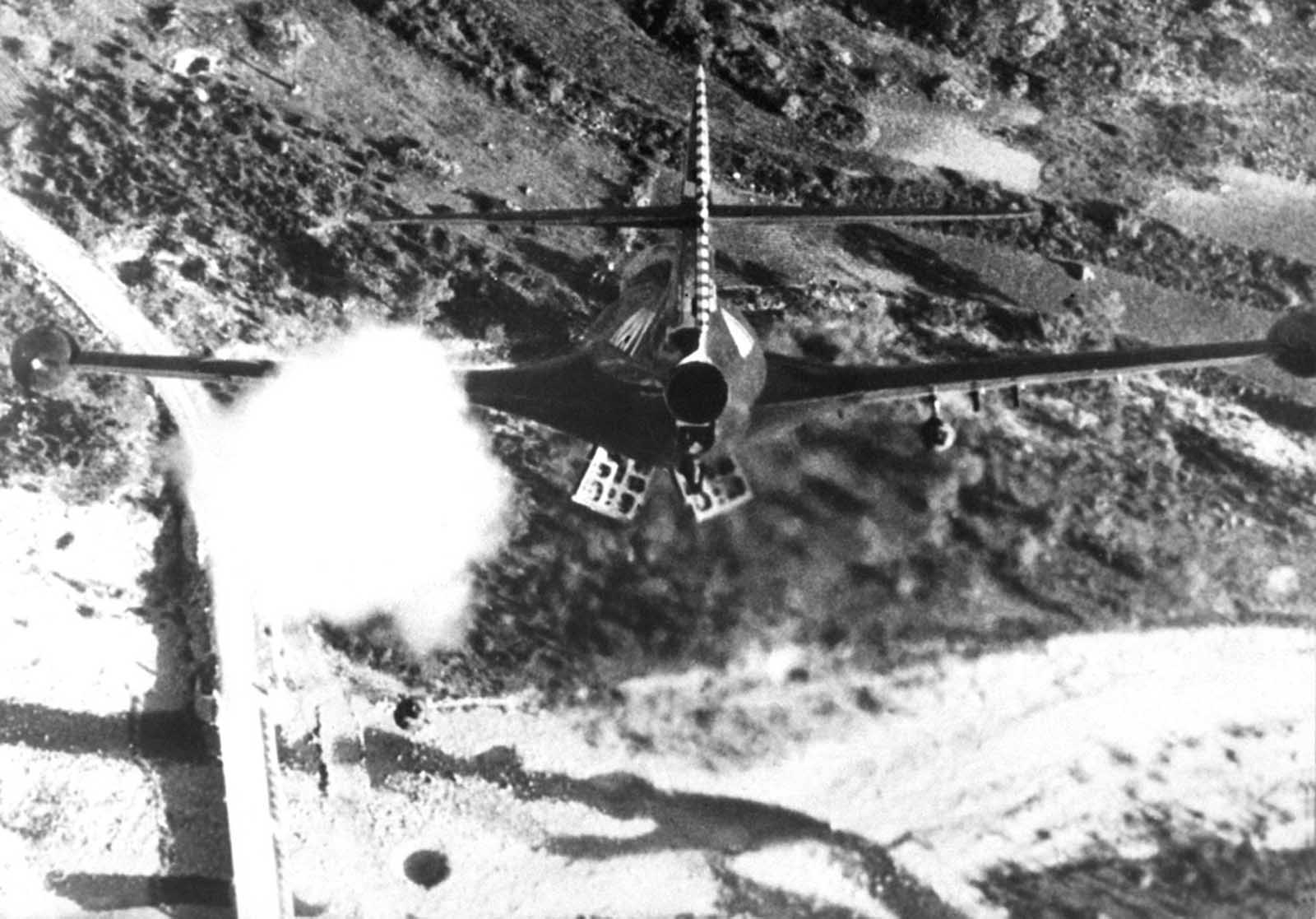 Lt. R. P. Yeatman, from the USS Bon Homme Richard, rocketing and bombing a Korean bridge in November of 1952.