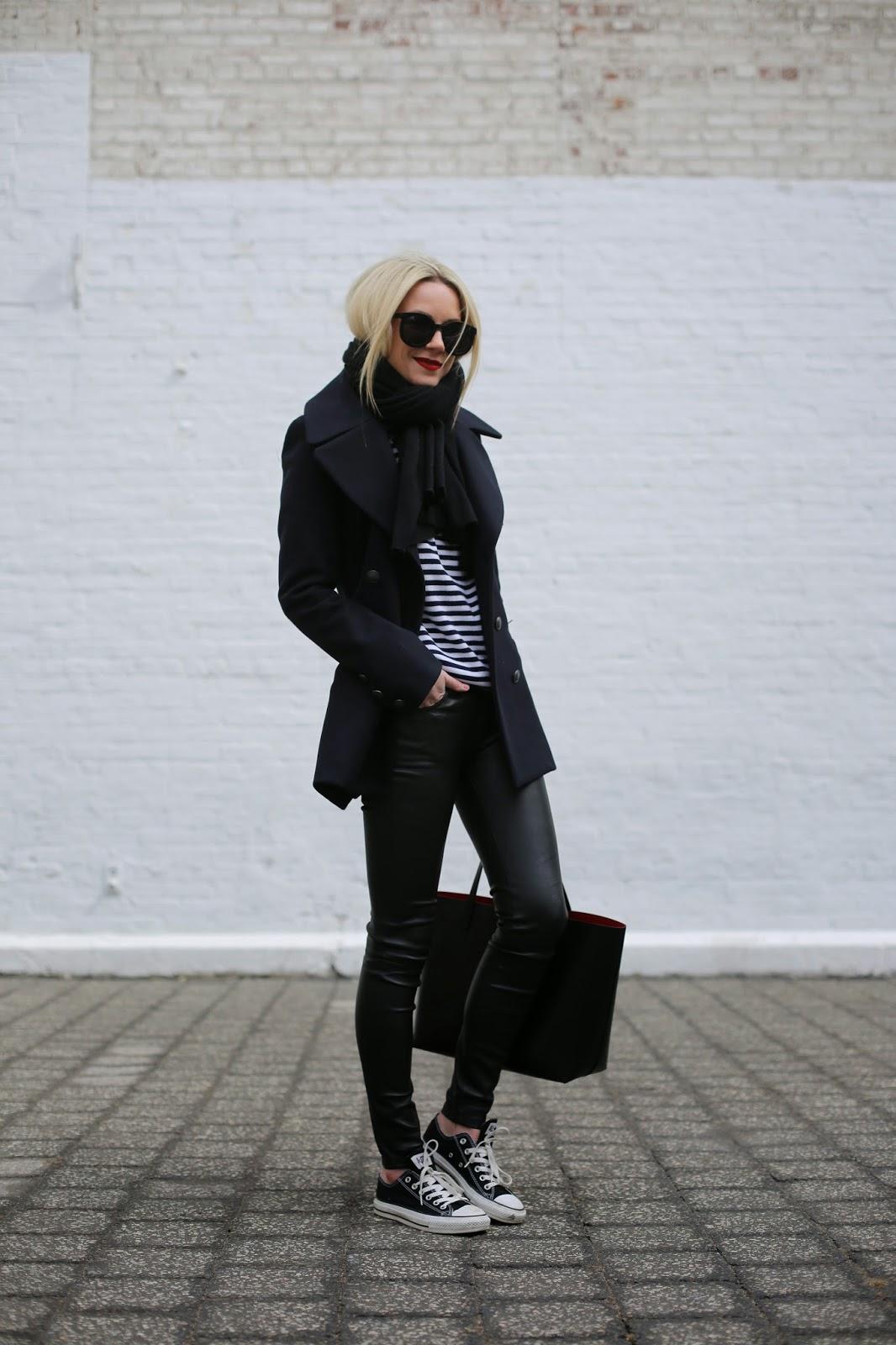 Blonde lady wearing black converse