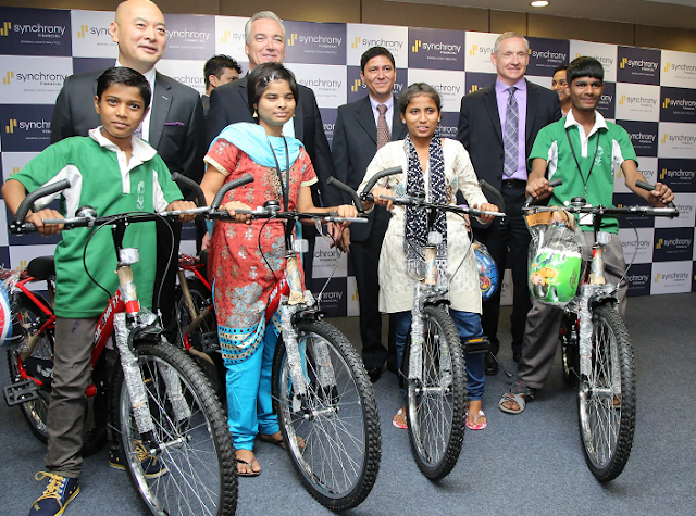 Synchrony Financial Senior Leadership Team assembles the bicycles and supports Don Bosco Navajeevan Foundation