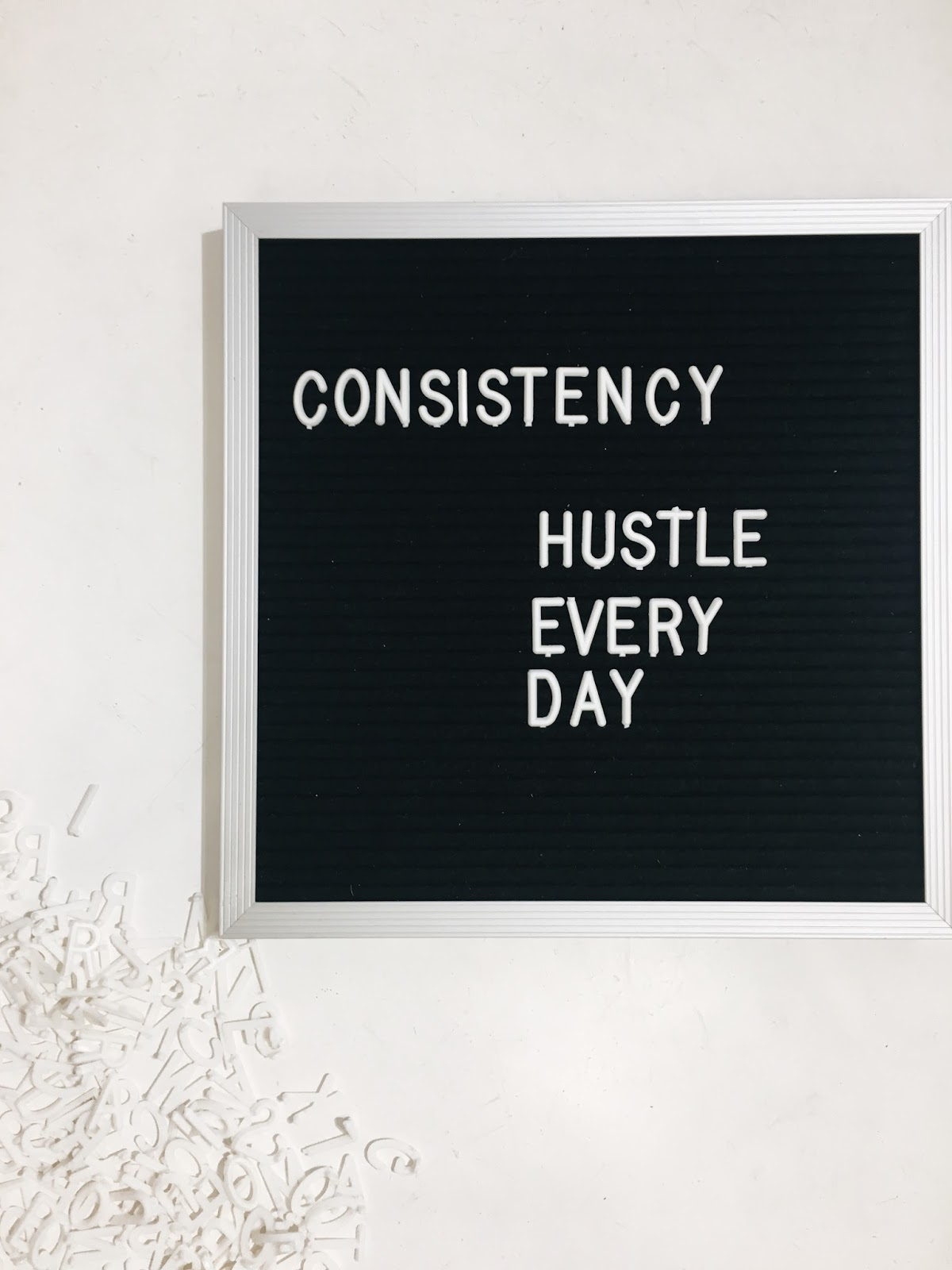 hustle consistency letter board
