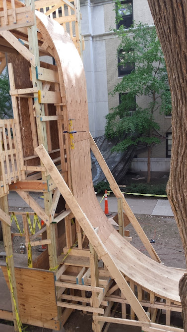 three storey tower and plywood track of wooden roller coaster