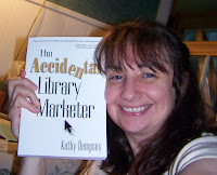 author Kathy Dempsey holding her book, The Accidental Library Marketer