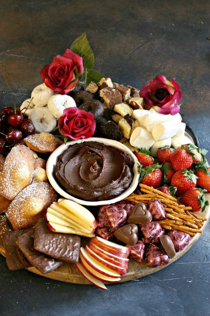 Tips and tricks for building a Valentine's Day dessert treat board including chocolate hummus, fruits and pastries.