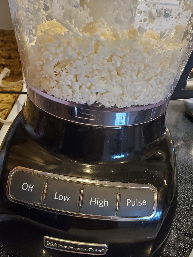 this is a head of cauliflower riced in a food processor