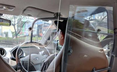 Driver Taksi Online Bikin Dinding Antibegal, Berapa Biayanya?