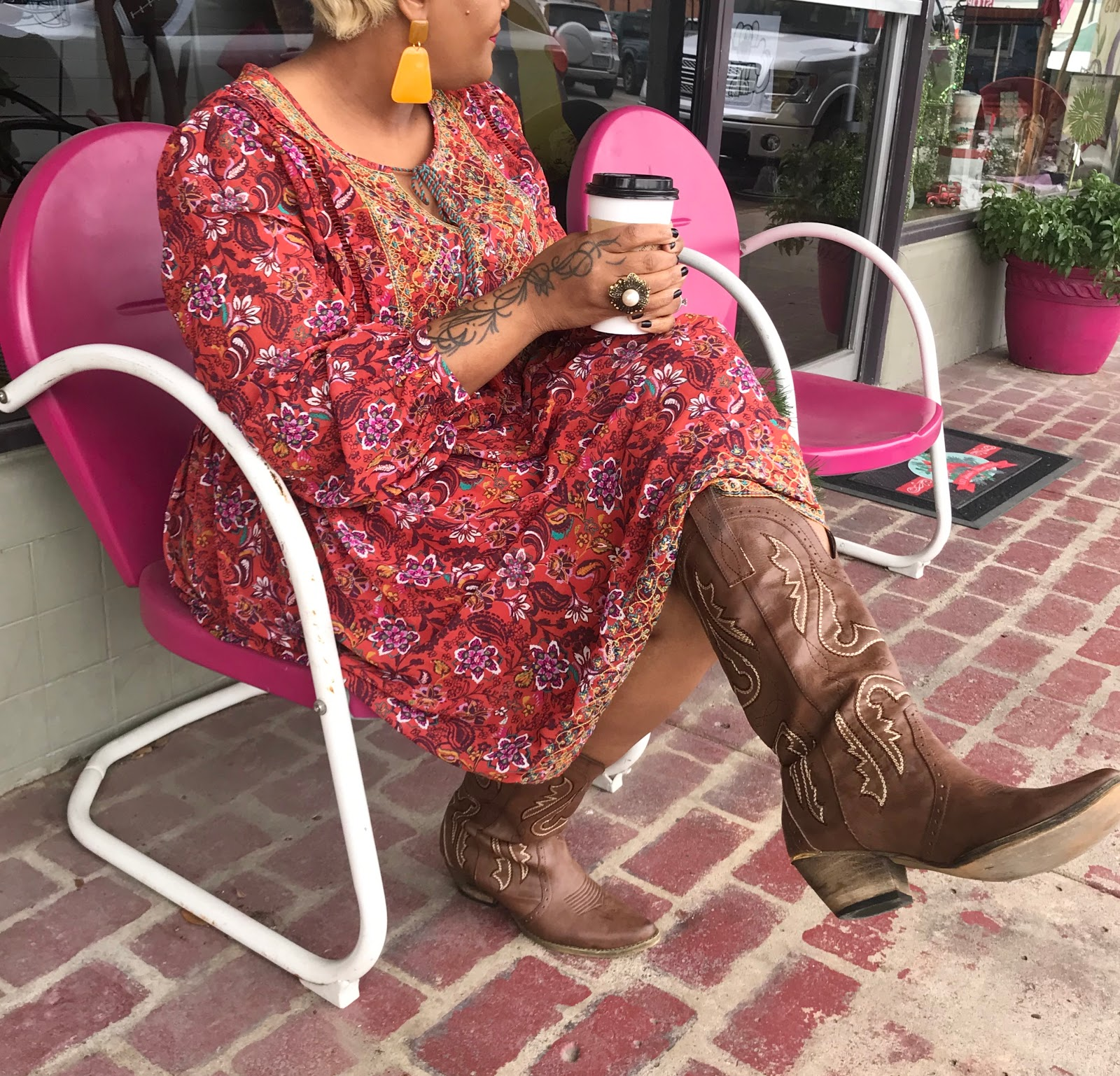 Wearing bobo dress with cowgirl boots and 70's inspired earrings. Judge My Style Outfit Of The Day