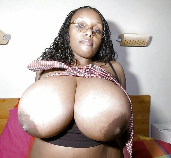 Amazing big tit ebony works her pussy 4