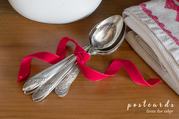 vintage silverware tied up with red velvet ribbon
