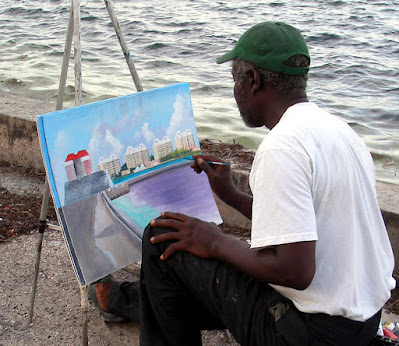 Artist painting at easel.