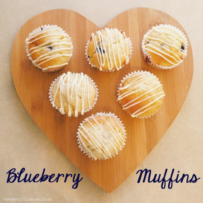 Deliciously moist and soft blueberry muffins made with greek yoghurt and a hint of vanilla, and drizzled with white chocolate. hungrylittlebear