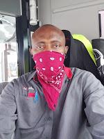 London busdriver wearing face mask