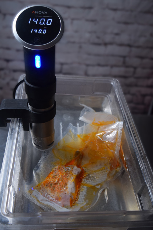 Using the Anova Precision Cooker to cook pork chops sous vide before grilling.