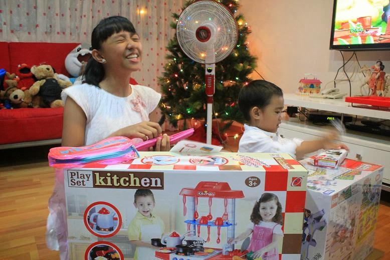 kids opening their Christmas gifts from Santa Claus