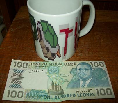 KoopaTV coffee mug branded cup Sierra Leone Leones dollar 100