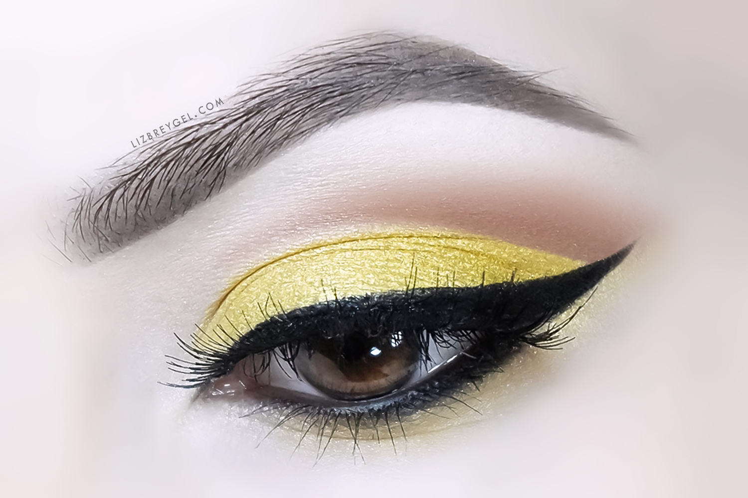 a close up image of eye with citrine birthstone inspired makeup look