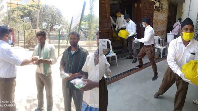 आरएसएस के कार्यकर्ताओं ने जरूरतमंदों को खाने के पैकेट और किराना सामान बांटा।