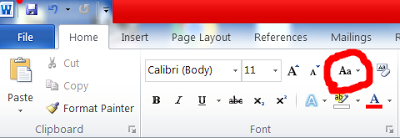 how to change font to caps lock in word