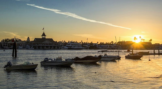 Landscape of boat, sea, beach and sunset at Newport Beach California