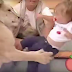 Terrifying as tame lion pounces on baby and bites her on live TV