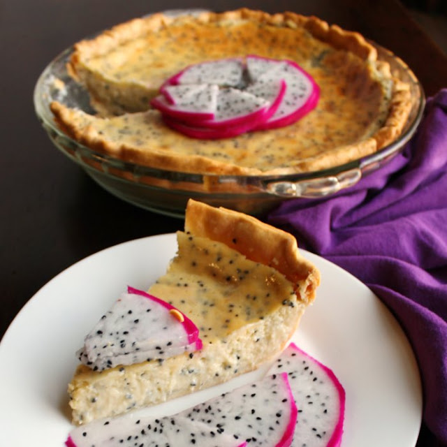 slice of creamy dragon fruit pie on plate with slices of fruit as garnish, remaining pie in background