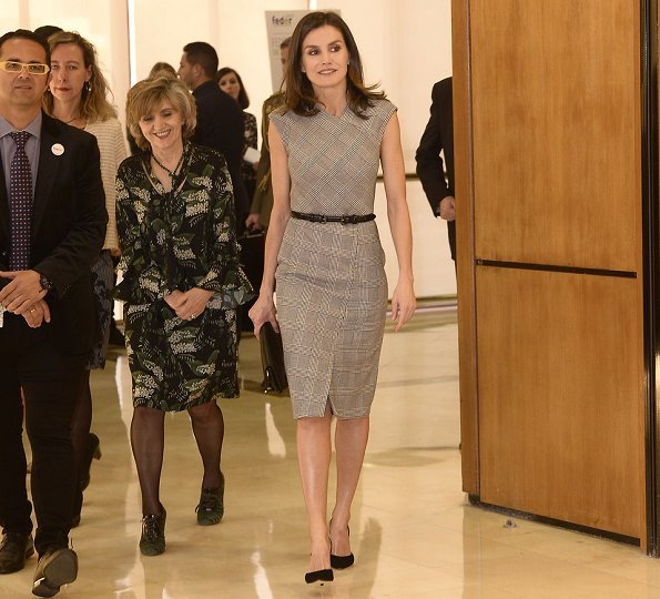 Queen Letizia carried Carolina Herrera black clutch. This year's event's theme is Bridging health and social care