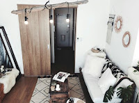 Small apartment decoration features black and white furniture
