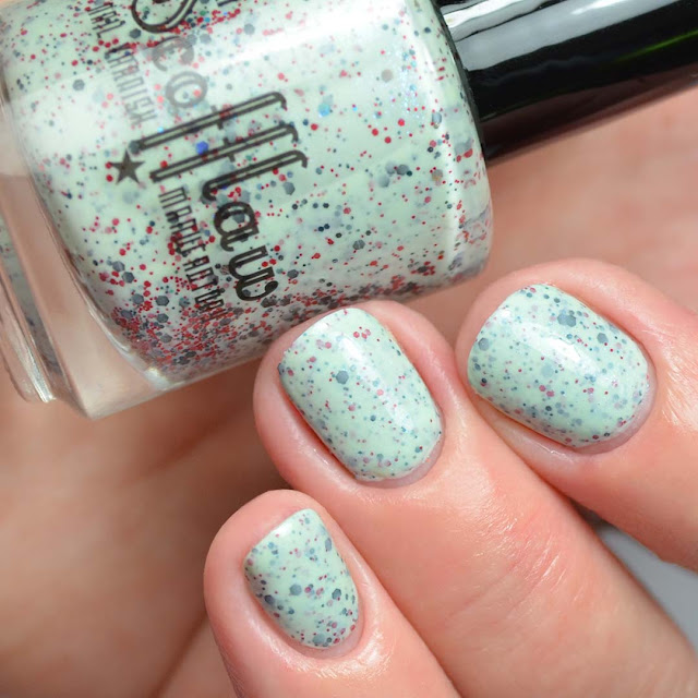 mint nail polish with red and black glitter swatch