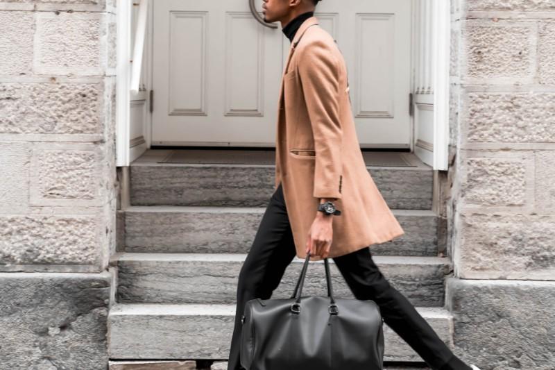 A man in light orange long coat.